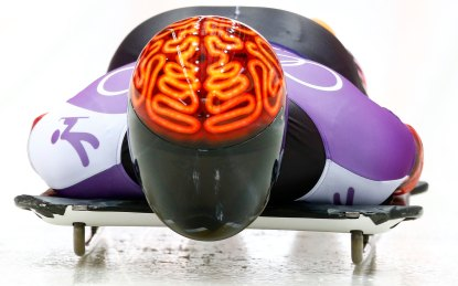 Canada's John Fairbairn speeds down the track during a men's skeleton training at the Sanki sliding center in Rosa Khutor