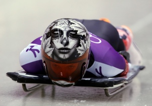 Sarah Reid of Canada starts a run during women's skeleton training at the 2014 Winter Olympics, Tuesday, Feb. 11, 2014, in Krasnaya Polyana, Russia. (AP Photo/Dita Alangkara)