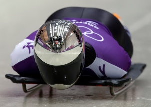 Matthias Guggenberger of Austria starts his run during the men's skeleton training at the 2014 Winter Olympics, Tuesday, Feb. 11, 2014, in Krasnaya Polyana, Russia. (AP Photo/Dita Alangkara)