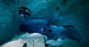 Divers in Cave