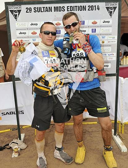 Team work: Pete and I crossed the finish line together and celebrate with our medals! (Photo credit: darabound.com)